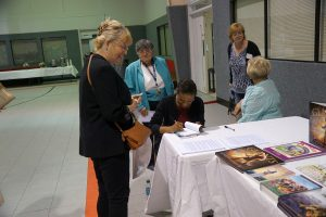 Trillia stayed to sign copies of her books